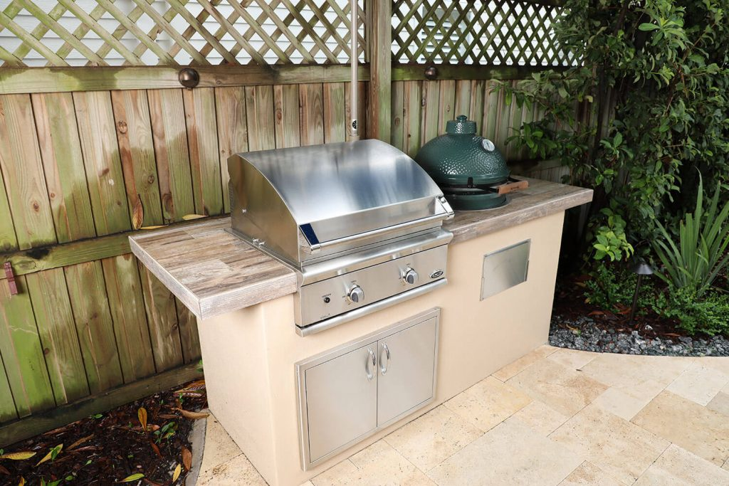 outdoor kitchen with dcs grill and big green egg