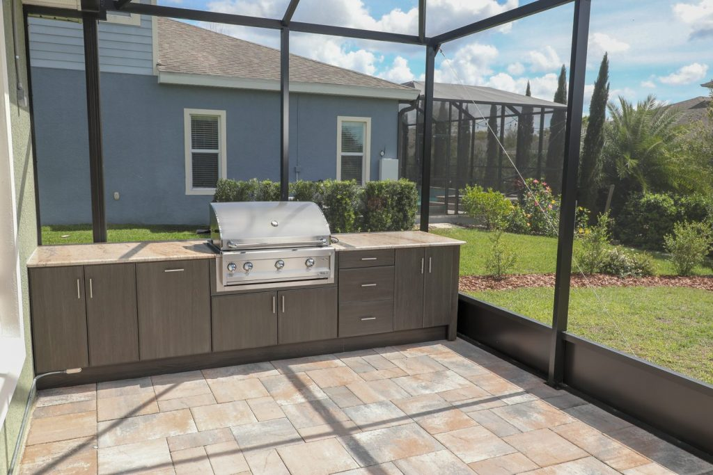 outdoor kitchen with artisan grill and outdoor cabinets