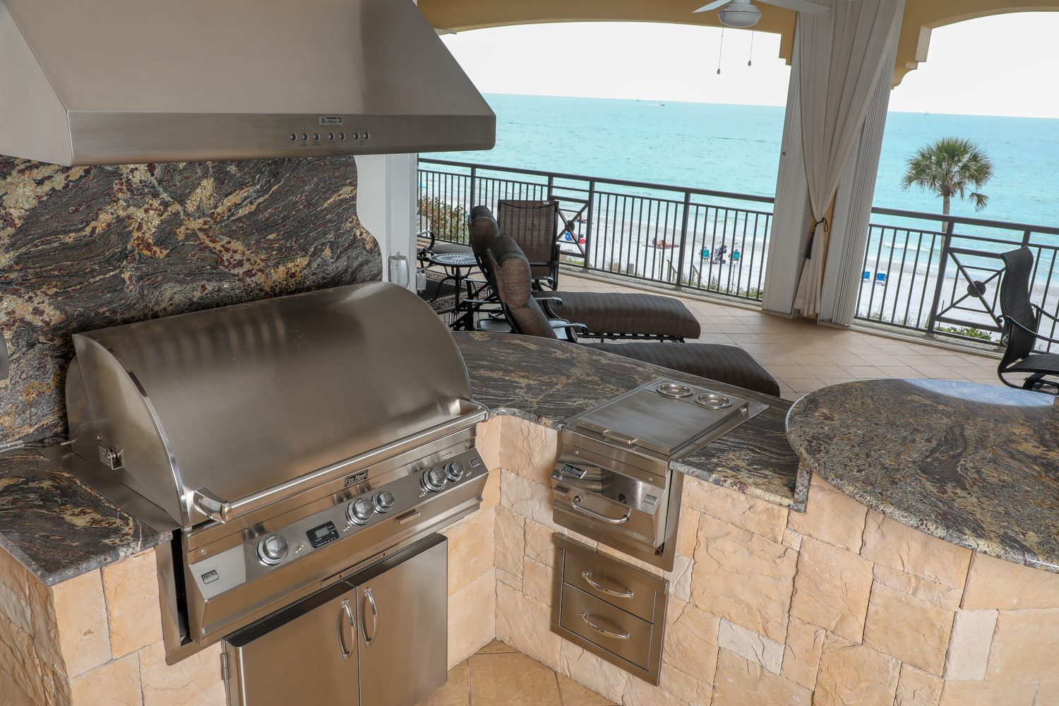 outdoor kitchen by the beach fire magic grill