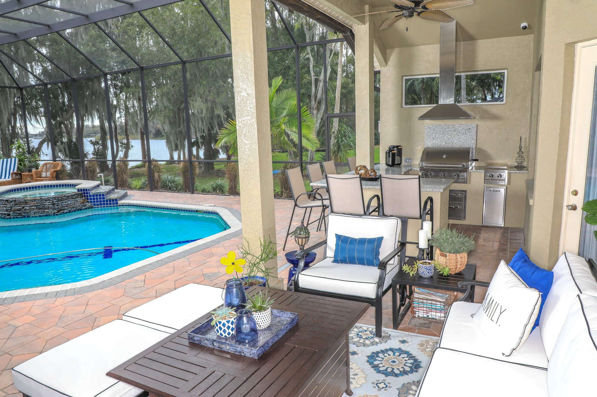 Outdoor Kitchen And Bar Seating Area On Pool Patio