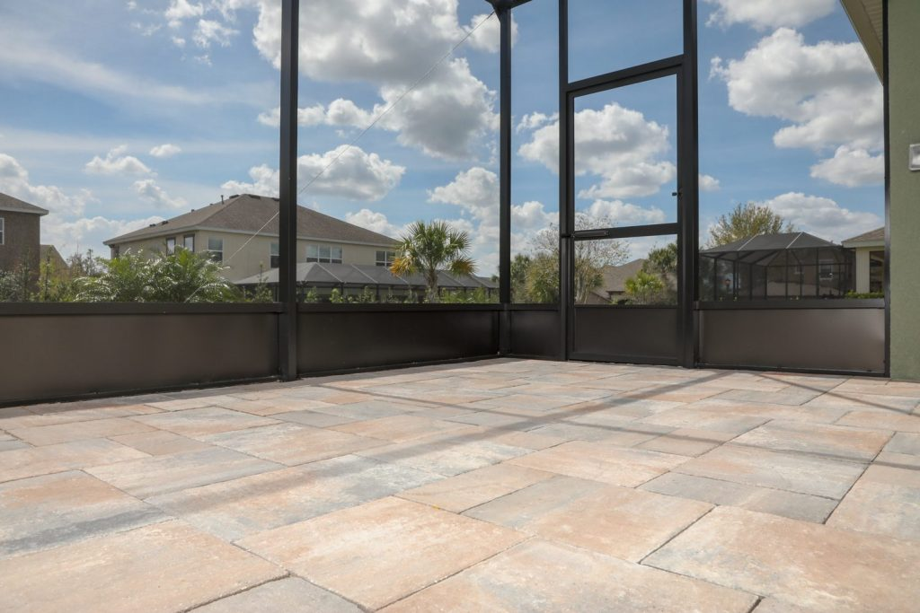 patio pavers and screen enclosure