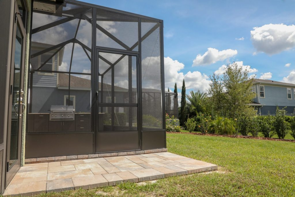 outdoor kitchen and screen enclosure